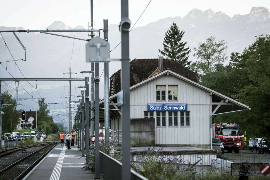 Emergency services attend the scene at Salez - Sennwald train station after a man attacked other passengers aboard a train at Salez, Switzerland, on Saturday, Aug. 13, 2016. Police in Switzerland say a Swiss man set a fire and stabbed people on a train in the country's northeast, wounding six people some seriously, and injuring himself. Photo: Gian Ehrenzeller — Keystone Via AP / KEYSTONE