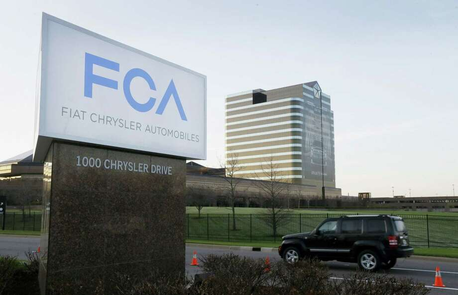AP Photo/Carlos Osorio, File In this May 6, 2014 photo, the Fiat Chrysler Automobiles sign is seen at Chrysler World Headquarters in Auburn Hills, Mich. Photo: AP / AP