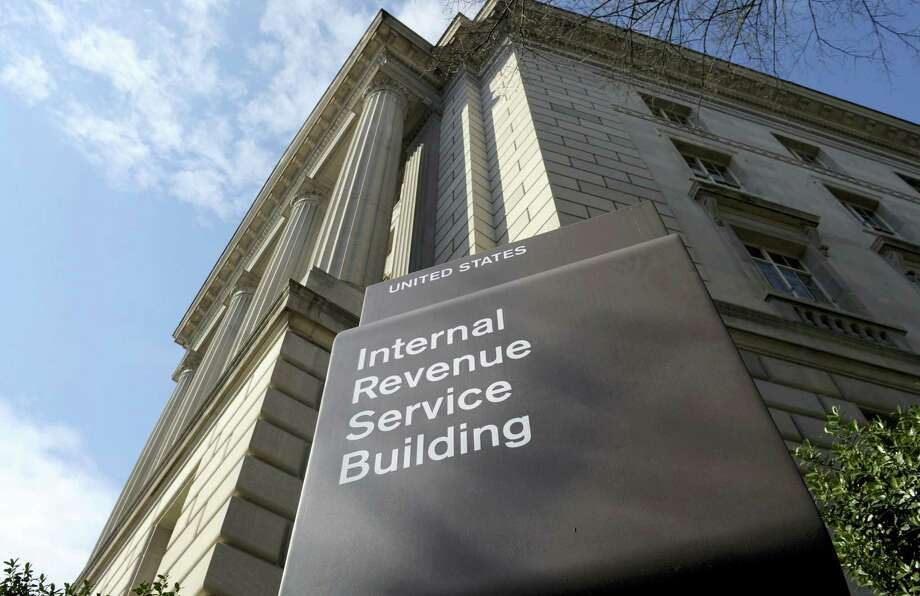 The exterior of the Internal Revenue Service building in Washington. As the end of the year approaches, it's time to think about taxes. The tax season may seem far off, but this is the time of year to make some moves to help your tax bill come spring. Photo: AP Photo/Susan Walsh, File  / Copyright 2016 The Associated Press. All rights reserved.