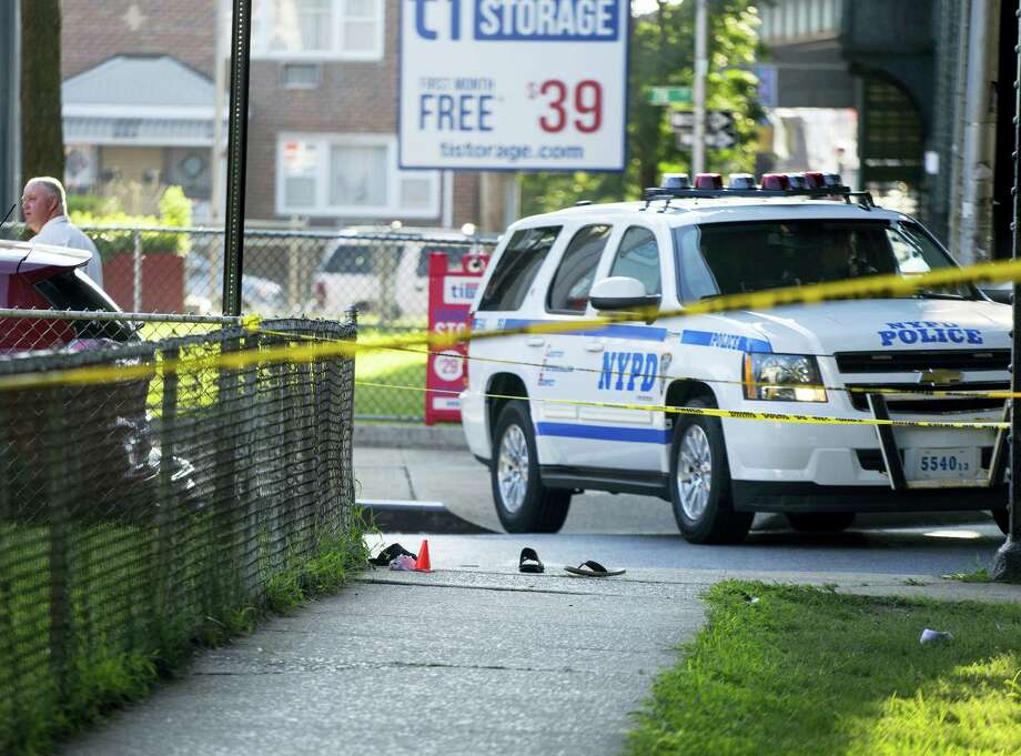 Sandals lay on a street corner at the crime scene, Saturday, Aug. 13, 2016, not far from the Al-Furqan Jame Masjid Mosque in the Ozone Park neighborhood of Queens, New York, where the leader of a New York City mosque has been fatally shot and an associate has been wounded in a brazen daylight attack. Photo: AP Photo — Craig Ruttle / FR61802 AP