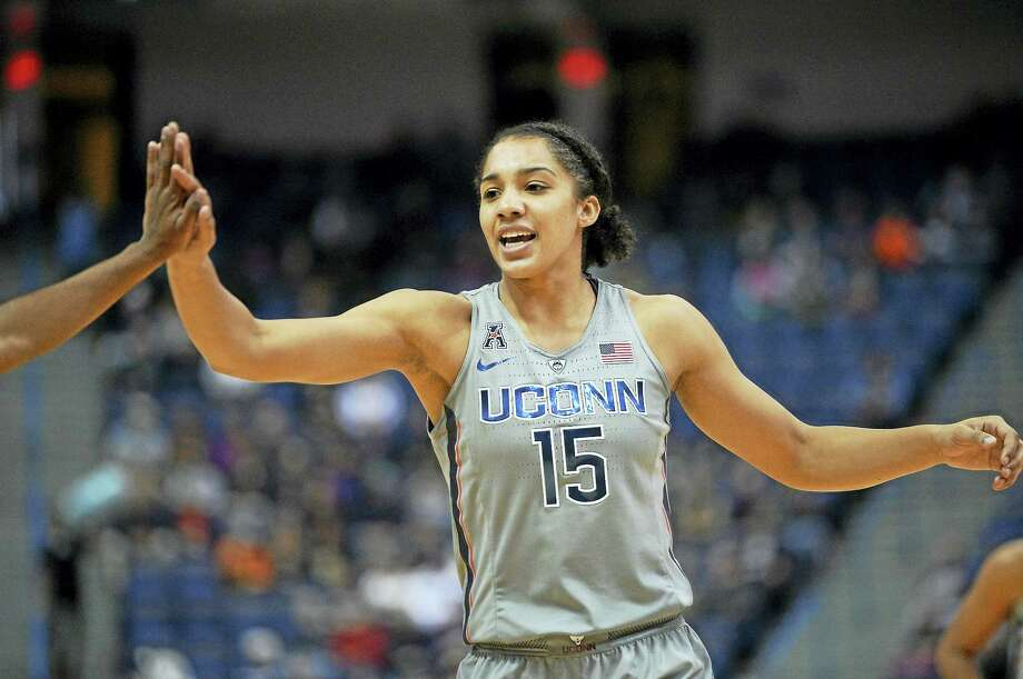 UConn's Gabby Williams high-fives a teammate during a game earlier this season. Photo: Jessica Hill — The Associated Press File Photo  / AP2016