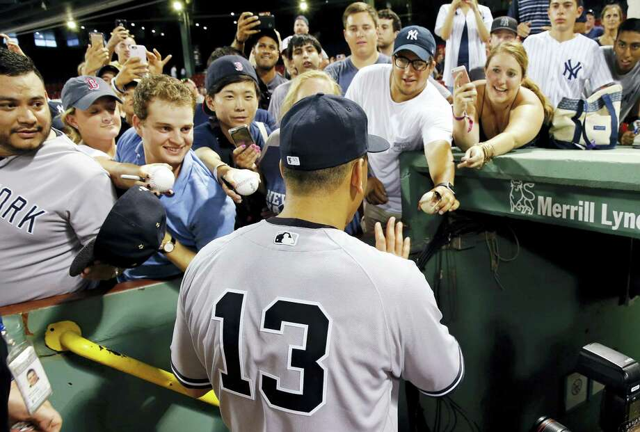 MICHAEL DWYER - THE ASSOCIATED PRESS New York's Alex Rodriguez greets fans as he enters the dug out following a baseball game against the Boston Red Sox in Boston, Thursday. The Yankees won 4-2. Photo: AP / AP