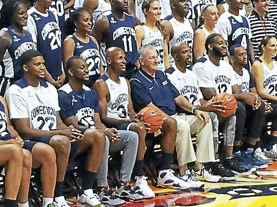 Former UConn coach Jim Calhoun poses for a photo with former players on Friday at his charity all-star game at Mohegan Sun. Photo: David Borges — Register