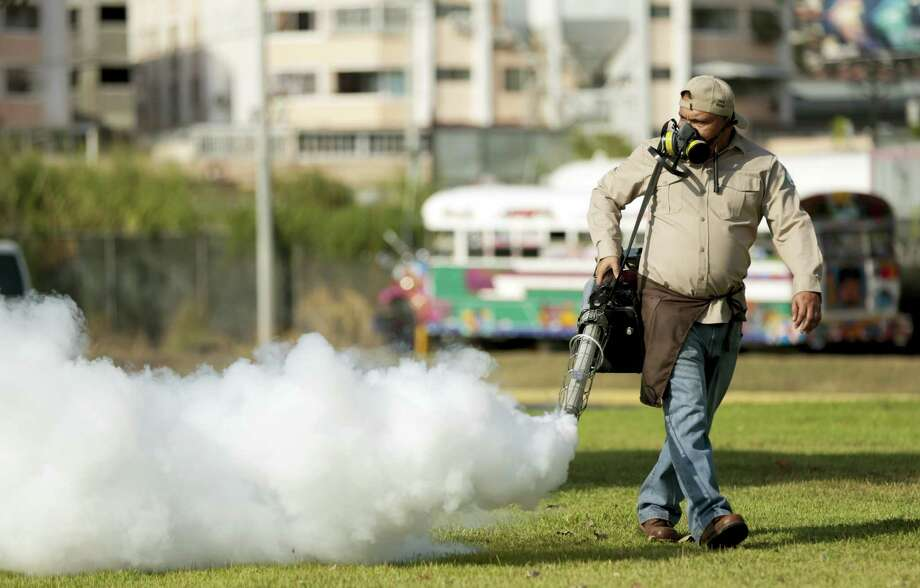 A health ministry worker fumigates for Aedes aegypti mosquitoes where carnival celebrations will be held in Panama City, Tuesday, Feb. 2, 2016. Authorities announced on Monday that 50 cases of the Zika virus infection have been detected in Panama's sparsely populated Guna Yala indigenous area along the Caribbean coast. The Aedes aegypti mosquito is vector for the spread of the Zika virus. Photo: AP Photo/Arnulfo Franco   / AP