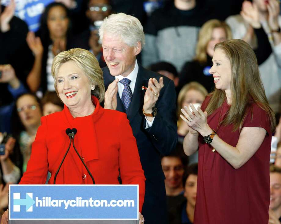Democratic presidential candidate Hillary Clinton speaks in front of former President Bill Clinton and daughter Chelsea during a caucus night rally at Drake University in Des Moines, Iowa on Feb. 1, 2016. Photo: AP Photo/Patrick Semansky  / AP