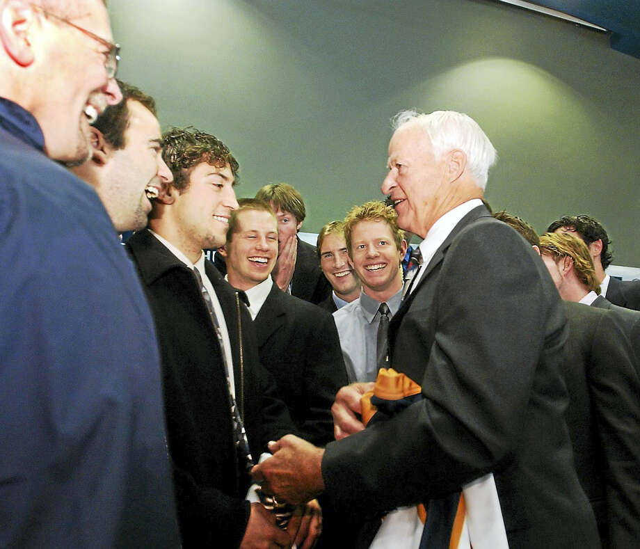 Hockey star Gordie Howe chats with the Quinnipiac hockey team after a press conference. Photo: Mara Lavitt — Register File Photo