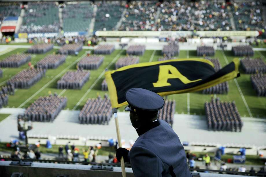 An Army Cadet signals Cadets as they march onto the field before a game against Navy in Philadelphia. Photo: The Associated Press File Photo  / Copyright 2016 The Associated Press. All rights reserved.