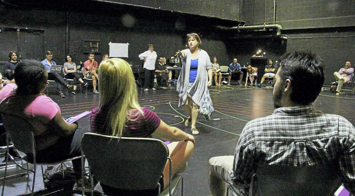 Producing Director Rebecca Goodheart addresses the cast and crew as Tina Packer (white shirt) looks on.
