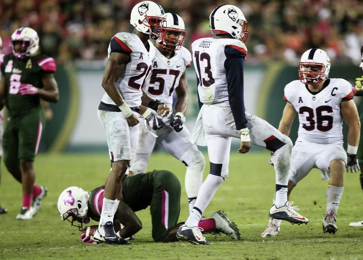 UConn linebacker Vontae Diggs (13) celebrates making a defensive stop against South Florida on Saturday.