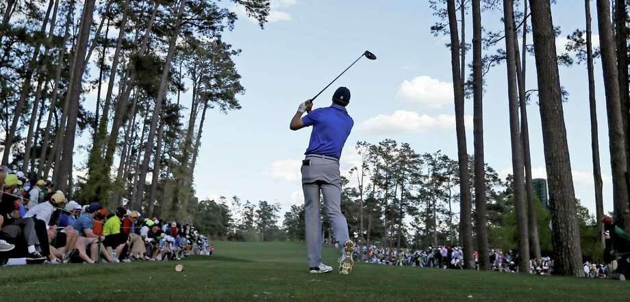 Jordan Spieth tees off on the 17th hole during the second round of the Masters on Friday. Photo: David J. Phillip — The Associated Press  / AP