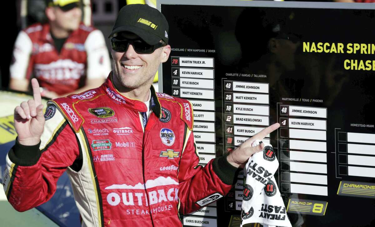 Kevin Harvick advanced to the next round of NASCAR's Chase for the Sprint Cup with a win Sunday at Kansas Speedway.