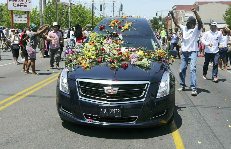 People reach out to touch the hearse carrying the body of Muhammad Ali as it drives down Broadway toward Cave Hill Cemetery, Tuesday, June 10, 2016, in Louisville, Ky. Photo: Michael Clevenger — The Courier-Journal, Pool   / The Courier-Journal POOL