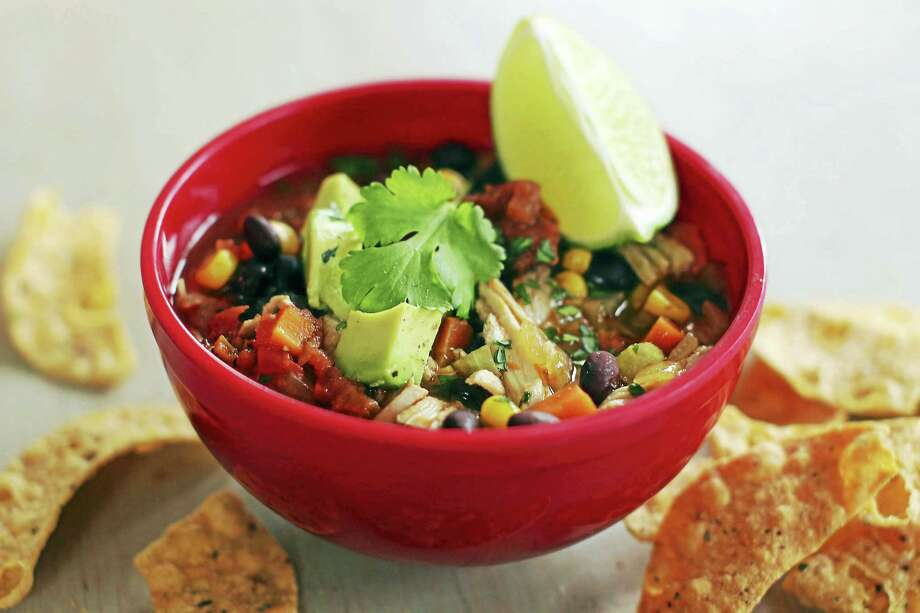 The secret to this quick and healthy Mexican chicken stew is that the chicken already has so much flavor that adding just a little spice and a little lime juice gives it all the complexity it needs. Photo: Matthew Mead — The Associated Press File Photo  / 170582 fre