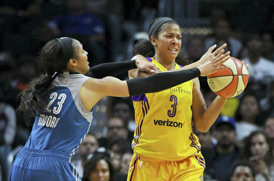 Lynx forward Maya Moore, left, reaches in on Sparks forward Candace Parker during the first half on Sunday. Photo: Mark J. Terrill — The Associated Press  / Copyright 2016 The Associated Press. All rights reserved.