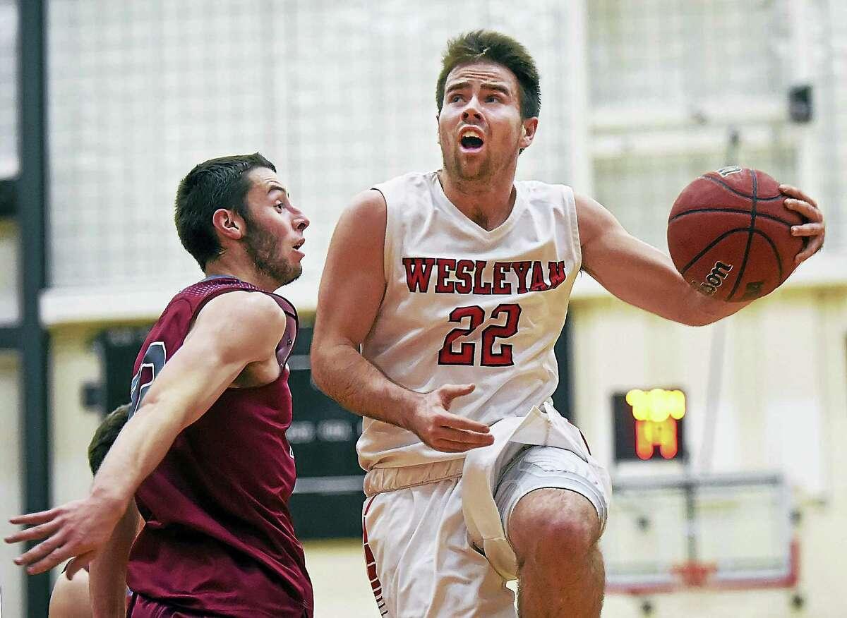 Wesleyan senior guard Harry Rafferty elevates to the hoop as Vassar sophomore forward Mason Dyslin defends Wednesday night at Silloway Gymnasium.