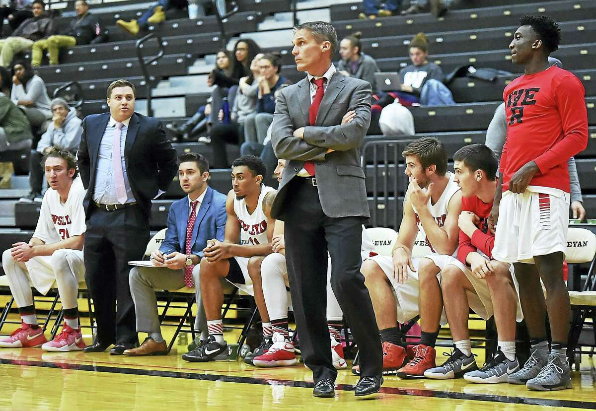Wesleyan head coach Joe Reilly on the sidelines as the Cardinals remain undefeated with a 77-53 win over Vassar on Wednesday.