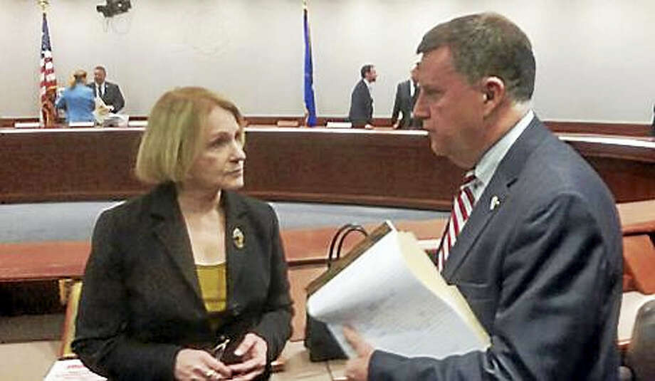 Sen. Timothy Larson, D-East Hartford, right, talking with Dora Schriro, commissioner of emergency services and public protection, following a forum on a proposed state police firing range. Photo: STEVE MAJERUS-COLLINS PHOTO Via CTNJ