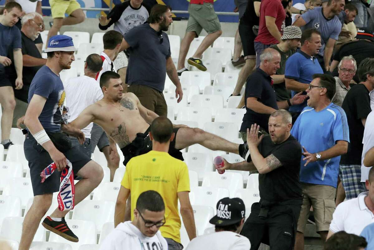 Clashes break out in the stands after the Euro 2016 Group B soccer match between England and Russia, at the Velodrome stadium in Marseille, France, Saturday, June 11, 2016. AP Photo — Thanassis Stavrakis