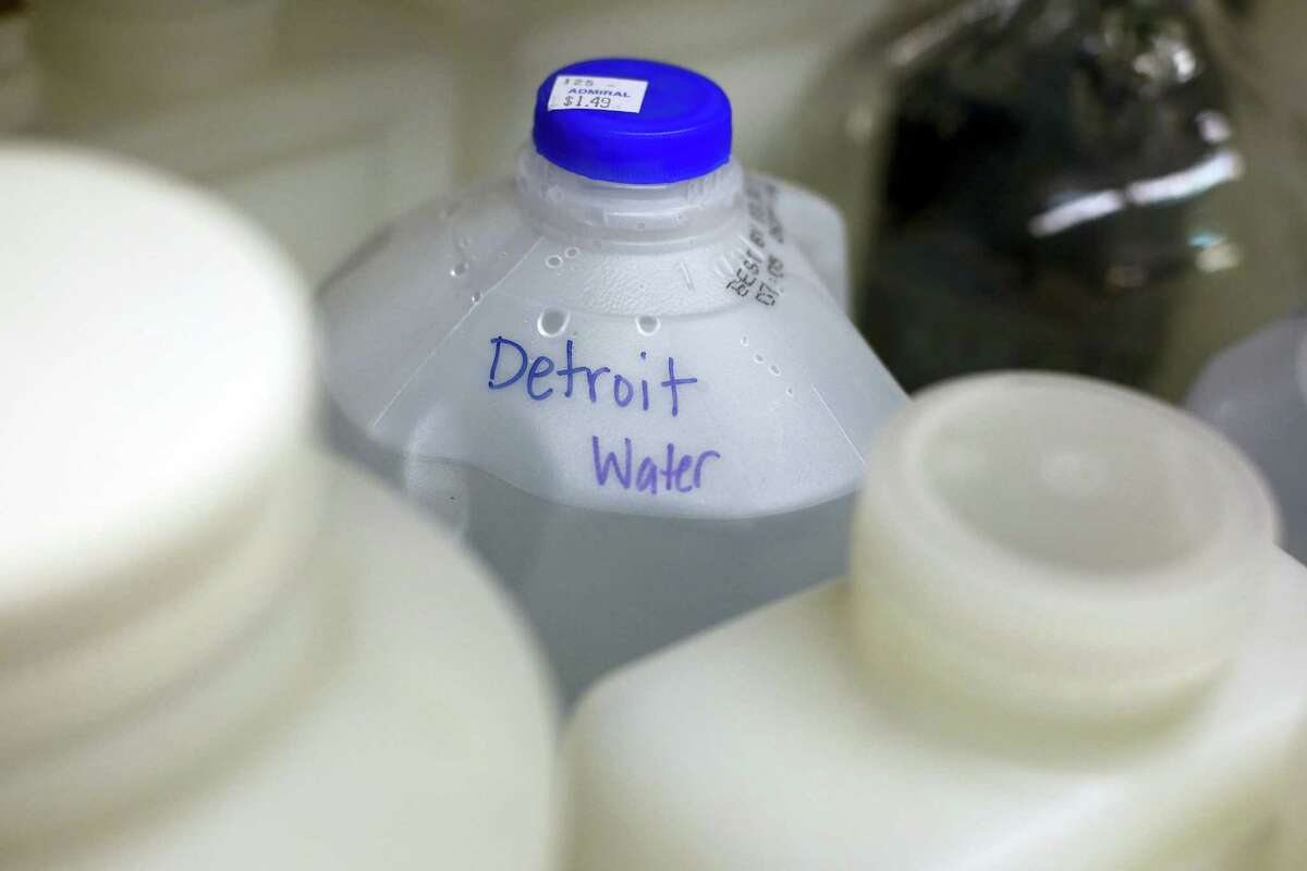 """A jug of water labeled """"Detroit Water"""" sits among other containers collected in Flint, Mich., in the Fluvial Processes, Pipeline Corrosion lab on the Virginia Tech campus in Blacksburg Va."""