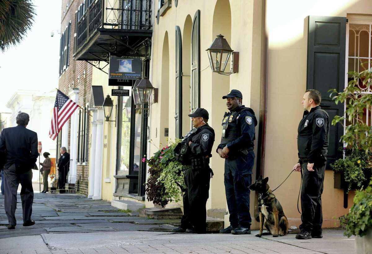 Homeland Security patrol the streets outside the Federal Courthouse Wednesday, Dec. 7, 2016, in Charleston, S.C., during Dylann Roof's trial. Roof, a white man, is accused of killing nine black people at a church.