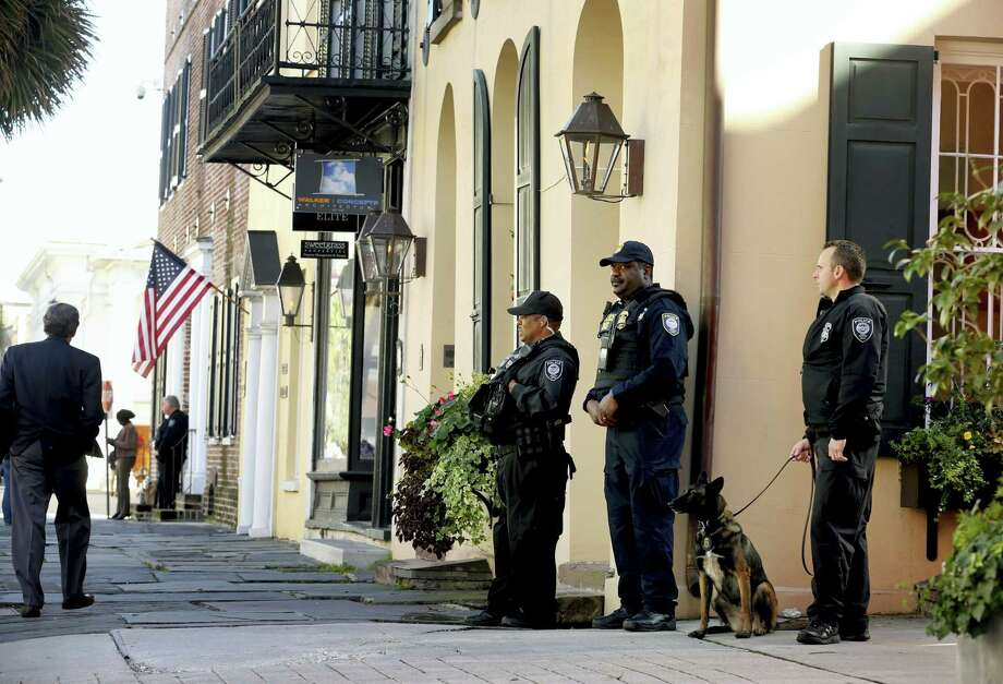 Homeland Security patrol the streets outside the Federal Courthouse Wednesday, Dec. 7, 2016, in Charleston, S.C., during  Dylann Roof's trial. Roof, a white man, is accused of killing nine black people at a church. Photo: Grace Beahm — The Post And Courier Via AP   / The Post And Courier
