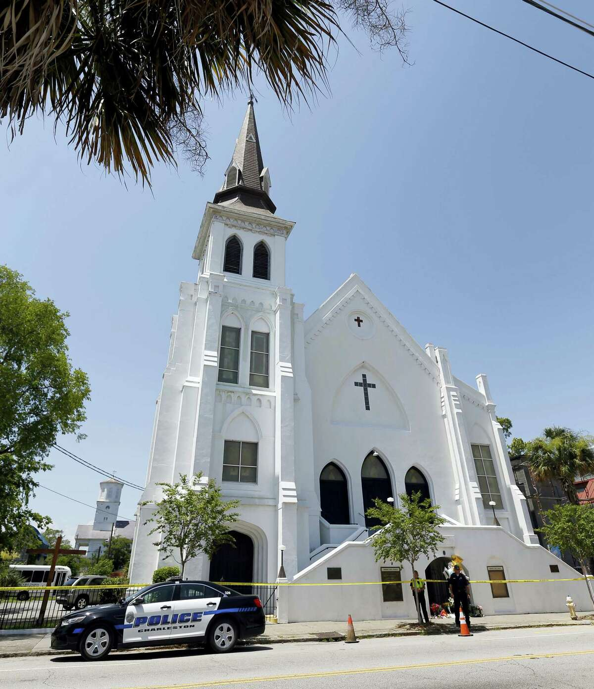 In this June 18, 2015, file photo, two Charleston police officers stand in front of the Emanuel AME Church in Charleston, S.C. The trial for Dylann Roof, a white man accused of killing nine black people at the church, started Wednesday, Dec. 7, 2016, at the federal courthouse in Charleston, SC.