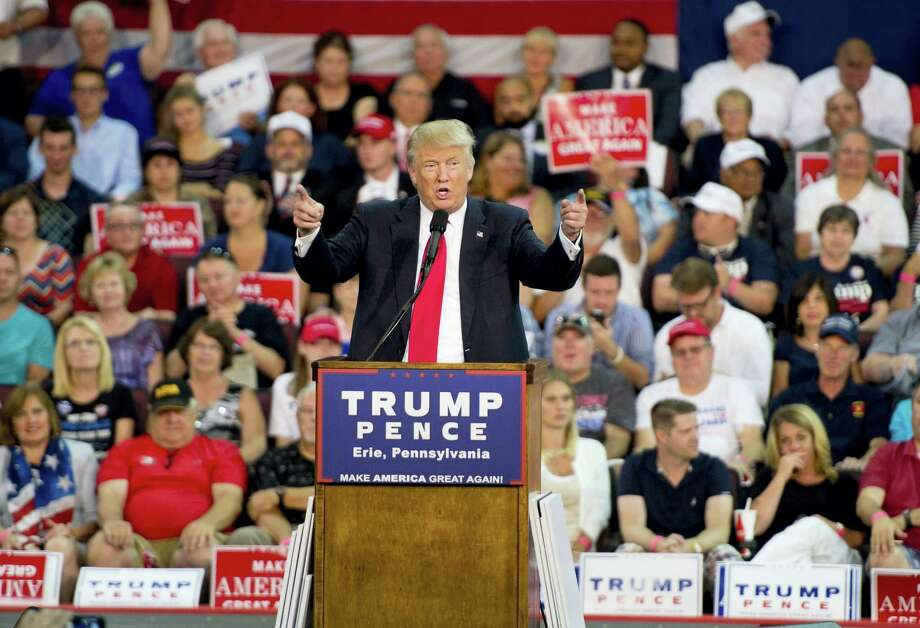 Republican presidential candidate Donald Trump gestures while speaking during a rally at Erie Insurance Arena on Friday in Erie, Pa. Photo: Andy Colwell — Erie Times-News Via AP / ERIE TIMES-NEWS
