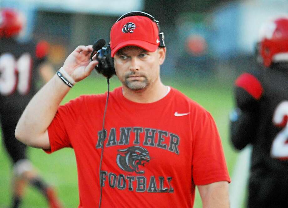 Cromwell/Portland football coach Chris Eckert celebrates a 39-7 win over Stafford at Pierson Park in this archive photograph. Photo: File Photo