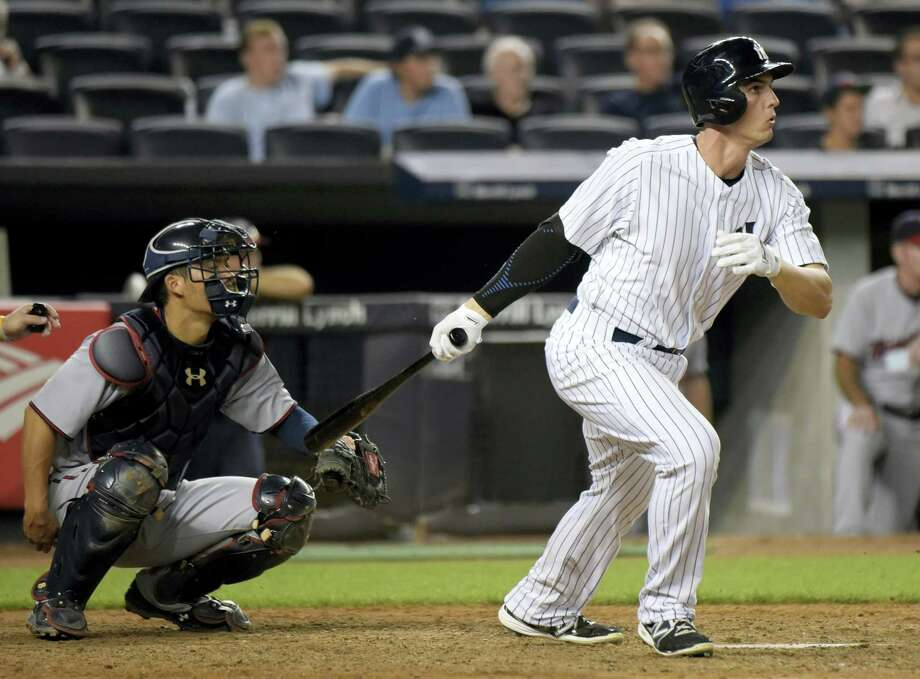 In this Aug. 17, 2015, file photo, New York Yankees' Greg Bird, right, hits a double as Minnesota Twins catcher Kurt Suzuki, left, looks on during the 10th inning of a baseball game in New York. Yankees first base prospect Bird will have right shoulder surgery Tuesday and will miss the entire 2016 season. Photo: The Associated Press  / FR51951 AP