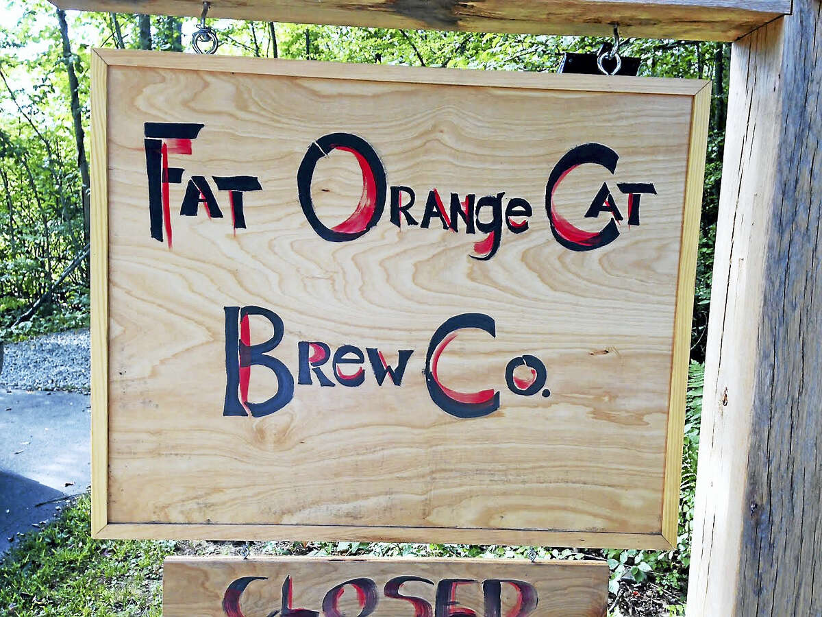 """On its website, Fat Orange Cat Brewery in East Hampton gives a tribute to the farm's namesake. """"We miss brewmaster Billy so much, but his love and passion for hanging out for hours and brewing will always live on through the name."""""""
