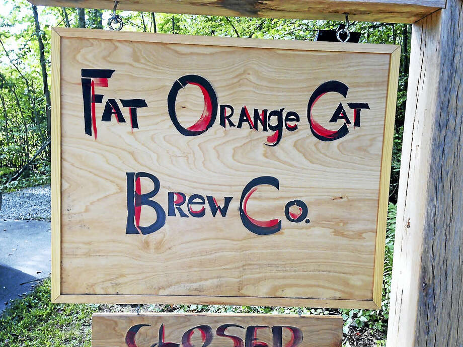 """On its website, Fat Orange Cat Brewery in East Hampton gives a tribute to the farm's namesake. """"We miss brewmaster Billy so much, but his love and passion for hanging out for hours and brewing will always live on through the name."""" Photo: Eileen McNamara — Special To The Press"""