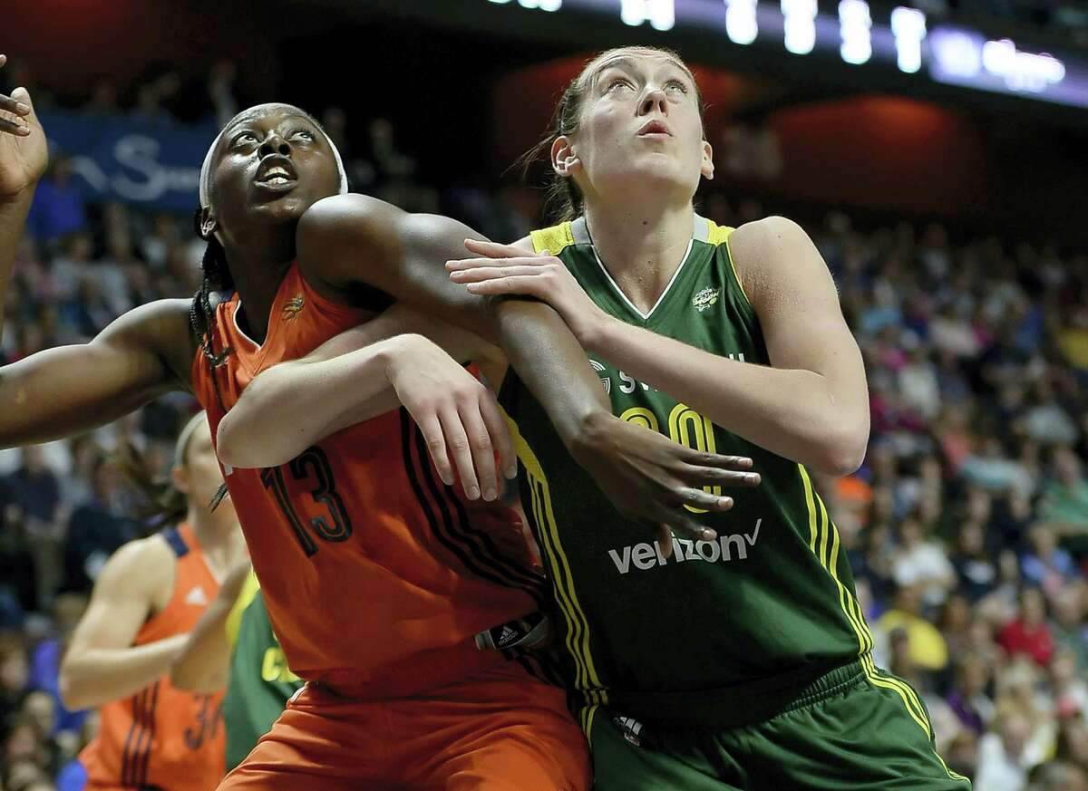 The Sun's Chiney Ogwumike, left, and the Storm's Breanna Stewart battle for a rebound during Friday night's game.