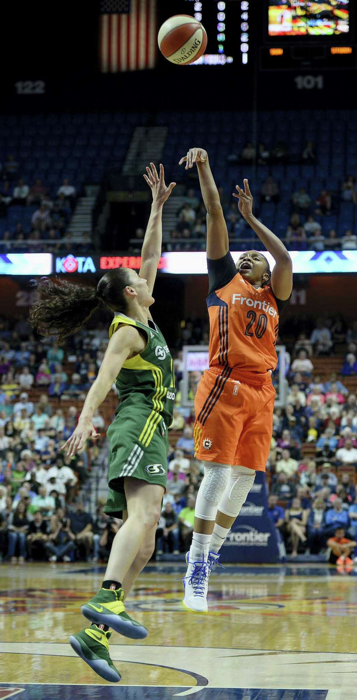 The Sun's Alex Bentley, right, shoots over the Storm's Sue Bird during the first half.