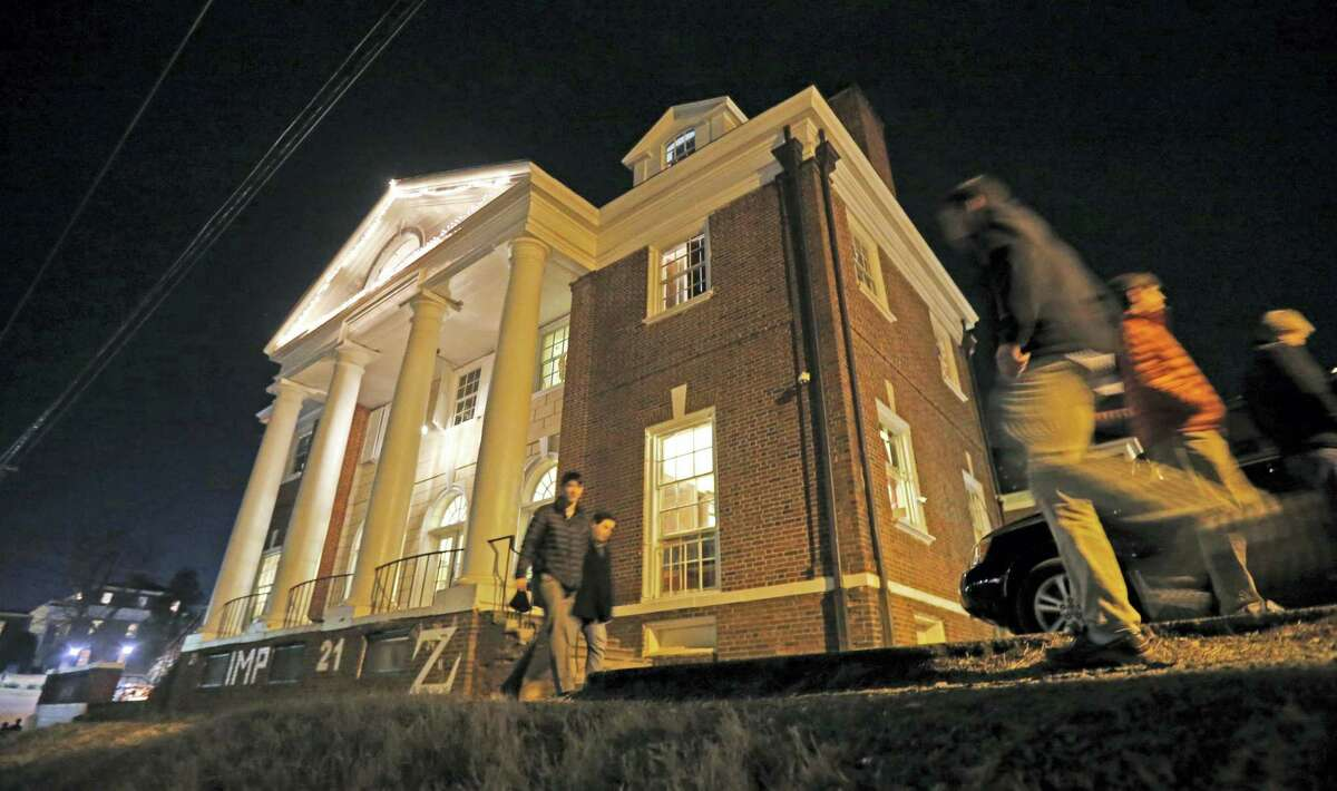 """In this Jan. 15, 2015 photo shows students participate in rush pass by the Phi Kappa Psi house at the University of Virginia in Charlottesville, Va. The house was depicted in a debunked Rolling Stone story as the site of a rape in September of 2012. A defamation trial against the magazine is set to begin on Monday, Oct. 17, 2016 over its article about """"Jackie"""" and her harrowing account of being gang raped in a fraternity initiation."""