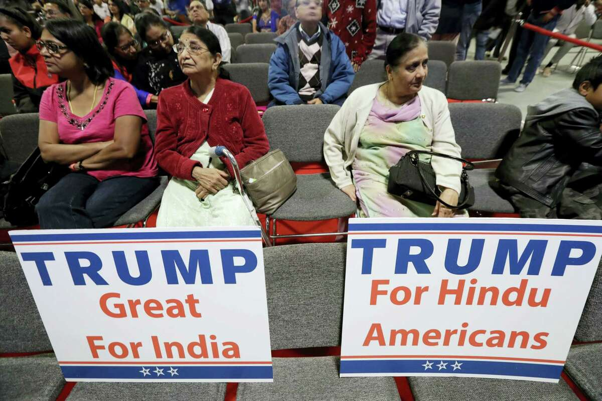 Signs are placed on seats as people wait for a charity event hosted by the Republican Hindu Coalition on Oct. 15, 2016 in Edison, N.J. Republican presidential candidate Donald Trump spoke during the event.