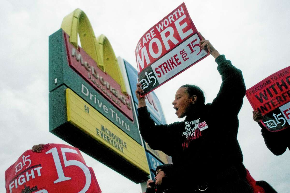 Fast-food worker Michelle Osborn, 23, of Flint, Mich. shouts out chants as she and a few dozen others strike outside of a McDonald's restaurant demanding better pay.