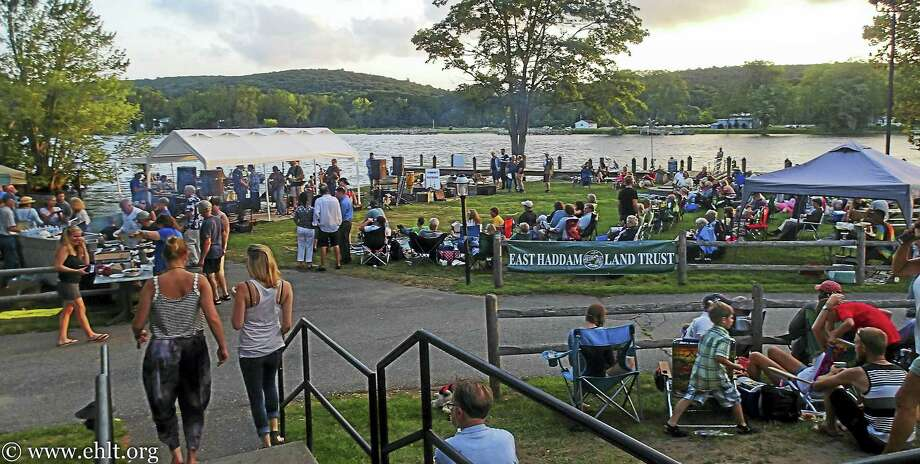 """Musical Bridges Donor Pledges $5,000 To East Haddam Land Trust Aug. 4, 2016 East Haddam - An anonymous donor has pledged to match all donations, up to $5000 collected during East Haddam Land Trust's Musical Bridges jam, August 29 on the Goodspeed Theatre lawn. """"We are very grateful for this pledge,"""" stated East Haddam Land Trust President, Pete Govert. """"The money raised will go to the Land Trust's Stewardship Endowment Fund, to be spent building bridges and maintaining trails on current and future preserves,"""" he added. The 2016 Musical Bridges concert will feature over 25 local musicians playing your favorite rock, blues, country and reggae songs in a jam band format - they will form pick-up bands to make music in the moment. There is no admission fee, but donations will be thankfully accepted.Bring friends and family for a Monday evening of music, August 29, 6:00-9:30 pm, on the Goodspeed Theatre lawn in East Haddam. Treat yourself to a BBQ sandwich and other goodies from the Gelston House (proceeds go to the Land Trust), and enjoy the sights and sounds of our beautiful Connecticut River valley.  More details at the East Haddam Land Trust website, www.ehlt.org, and on the East Haddam Land Trust Facebook page. Photo: Journal Register Co."""
