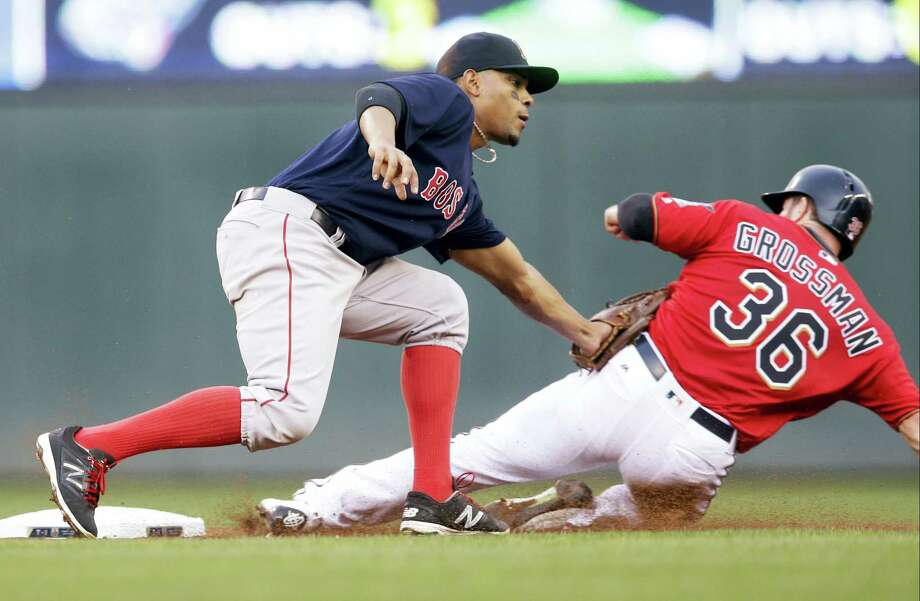 The Twins' Robbie Grossman, right, is tagged out by Red Sox shortstop Xander Bogaerts on a steal attempt on Friday. Photo: Jim Mone — The Associated Press  / Copyright 2016 The Associated Press. All rights reserved. This material may not be published, broadcast, rewritten or redistribu