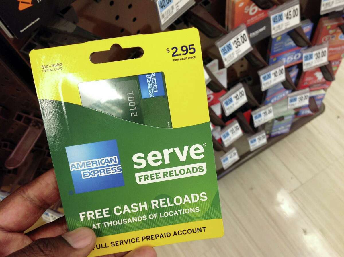 This March 7, 2016 photo shows an American Express Serve prepaid debit card for sale at a store in New York. Federal regulators announced new rules on Oct. 5, 2016, governing the quickly growing prepaid debit card industry, an effort more than two years in the making, which should bring basic account protections to its customers that are often the poor and financially disadvantaged.
