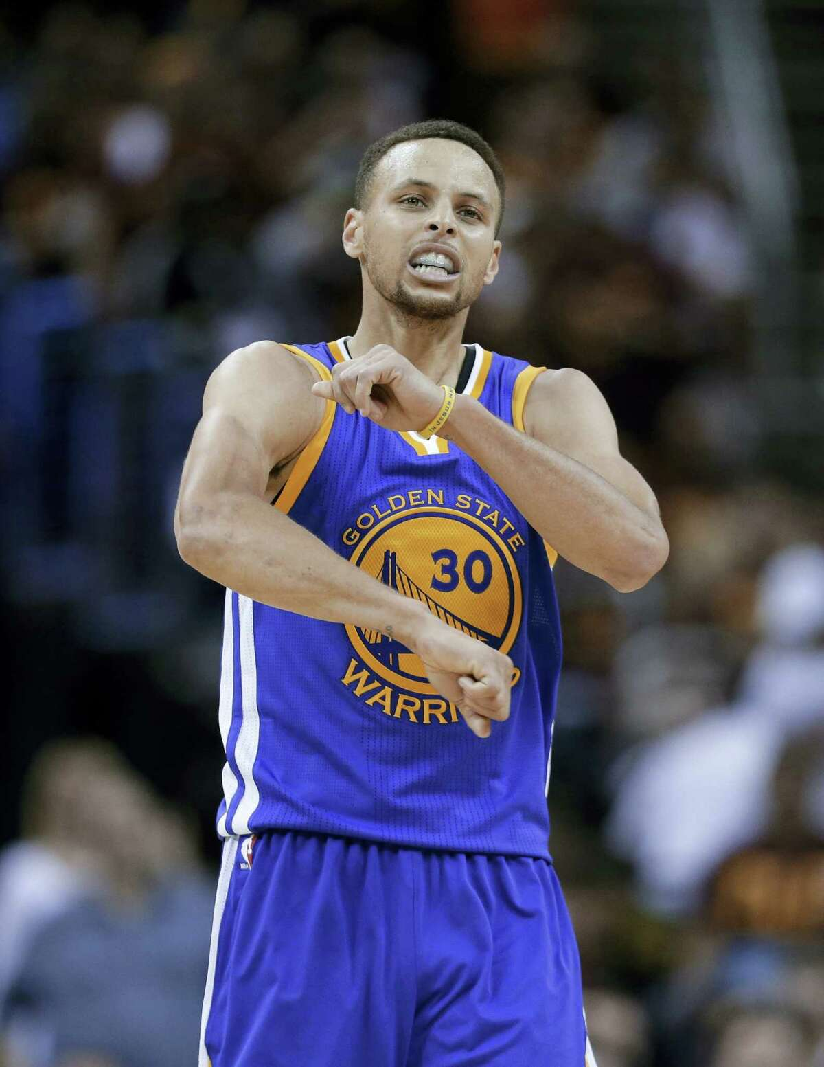 Warriors guard Stephen Curry celebrates a basket against the Cavaliers during the second half on Friday.