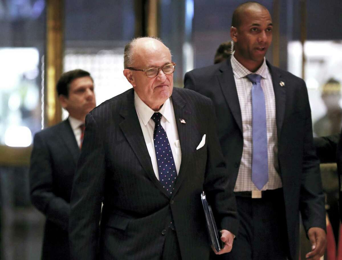Former New York Mayor Rudy Giuliani arrives at Trump Tower in New York.