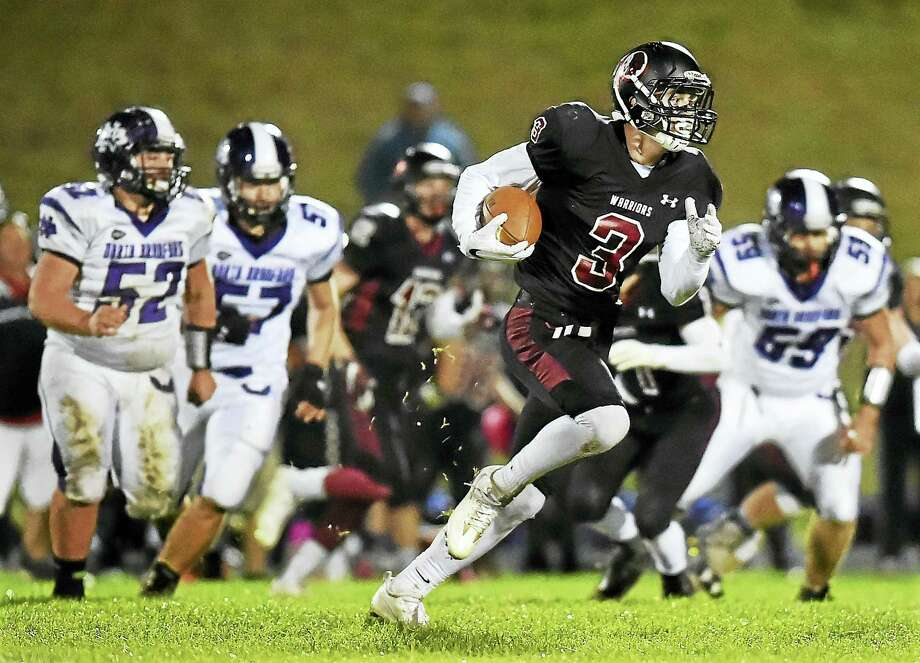 Valley Regional/Old Lyme senior Garret Burdick retuns and interception for a touchdown in the third quarter on Friday. Photo: Catherine Avalone — Register  / New Haven RegisterThe Middletown Press