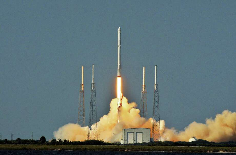 The SpaceX Falcon 9 rocket and Dragon capsule launches from Cape Canaveral Air Force Station's Launch Complex 40 on Friday, April 8. Photo: Tim Shortt — Florida Today Via AP)  / Florida Today