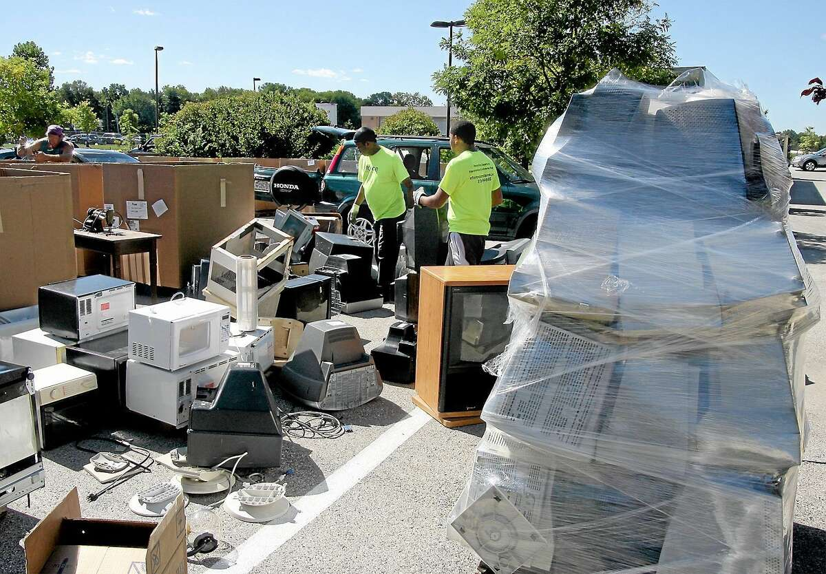 Electronic items are dropped off by residents during the city's annual recycling pickup day.