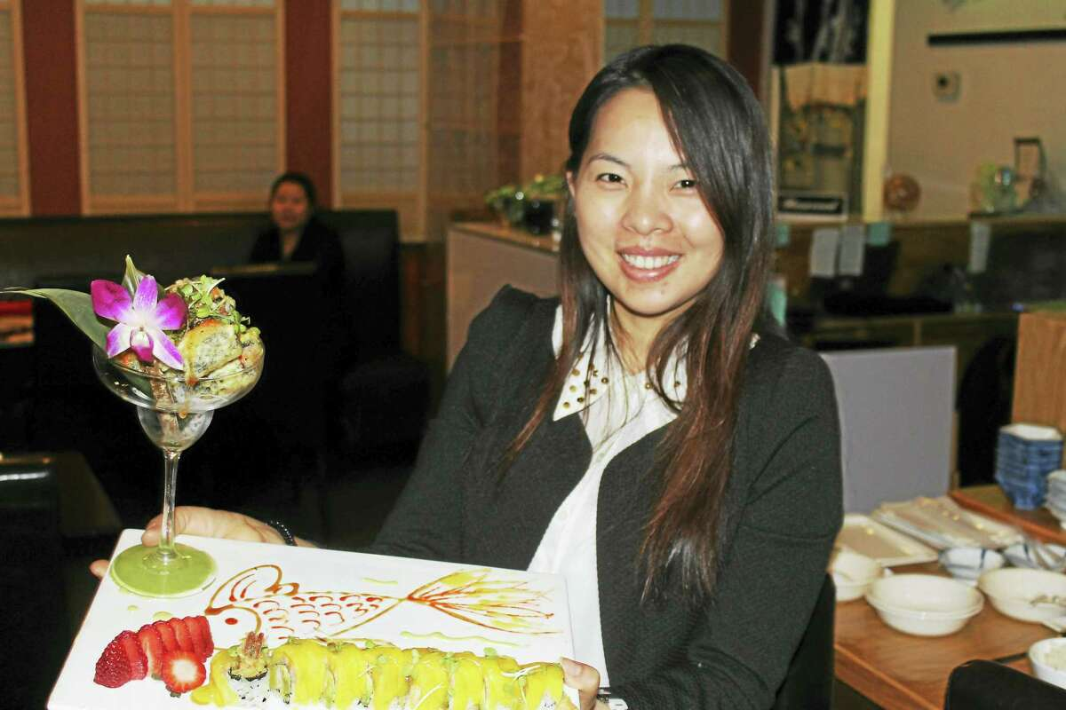 Maggie Huang, co-owner manager of Hachi on Main Street in Middletown, showcases one of the eatery's sushi dishes.