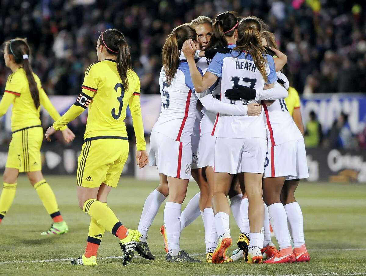 The United States women's team celebrate a goal by United States' Crystal Dunn during the first half of an international friendly soccer match against Colombia at Pratt & Whitney Stadium at Rentschler Field, Wednesday, April 6, 2016, in East Hartford, Conn. The U.S. won 7-0. (AP Photo/Jessica Hill)