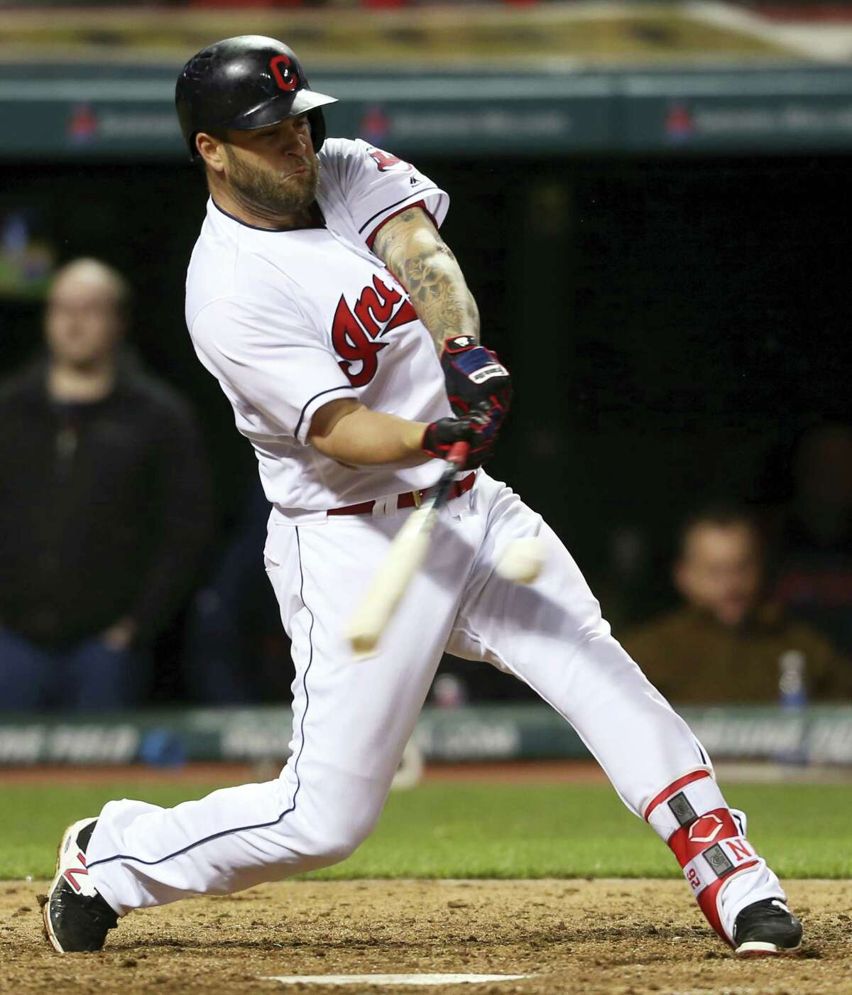 Cleveland Indians' Mike Napoli hits a solo home run off Boston Red Sox relief pitcher Junichi Tazawa during the seventh inning of a baseball game, Wednesday, April 6, 2016, in Cleveland. (AP Photo/Ron Schwane)