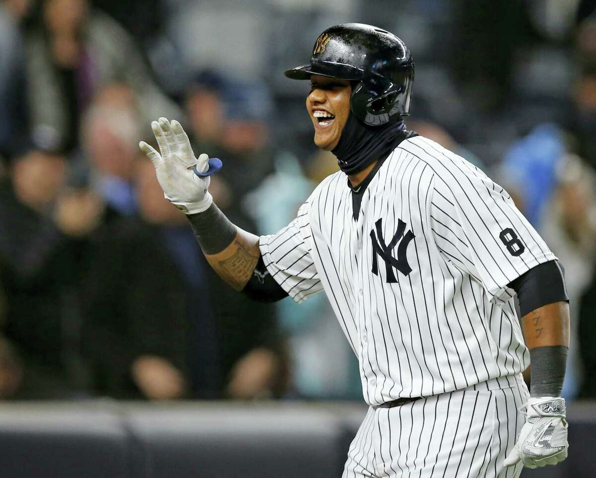 New York Yankees Starlin Castro reacts trotting toward home plate after hitting a second-inning, three-run, home run in a baseball game against the Houston Astros in New York, Wednesday, April 6, 2016. (AP Photo/Kathy Willens)