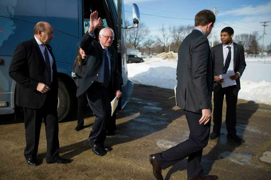 Democratic presidential candidate Sen. Bernie Sanders, I-Vt., waves as he arrives for a campaign rally at Delaware County Fairgrounds Saturday in Manchester, Iowa. Photo: The Associated Press  / AP