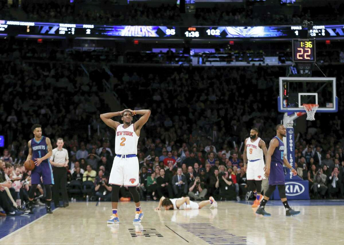 New York Knicks' Langston Galloway (2), Sasha Vujacic (18) and Kyle O'Quinn (9) react as Charlotte Hornets' Kemba Walker (15) and Courtney Lee (1) looks away during the second half of an NBA basketball game Wednesday, April 6, 2016, in New York. The Hornets won 111-97. (AP Photo/Frank Franklin II)